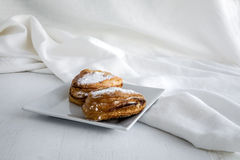 Cakes on table background and white fabric Royalty Free Stock Photo