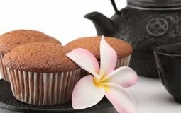 Cakes and tea. Cakes tea teapot flower breakfast isolated teacake Royalty Free Stock Photography