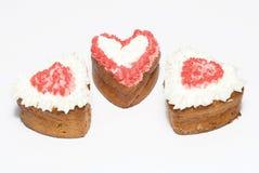 Cakes in vormhart op witte achtergrond Stock Fotografie