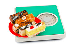 Cakes on weight scale Stock Image