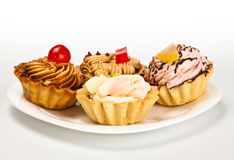 Cakes on white dish Royalty Free Stock Images