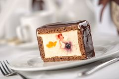 Cakes on a white plate, restaurant setting. Cream bakery pastry delicious food dessert chocolate closeup tasty slice sweet cafe cheesecake portion calories royalty free stock photos