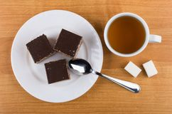 Cakes With Chocolate In Plate, Lumpy Sugar, Tea And Teaspoon Stock Photography