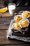 Cakes in a wooden box, a glass of milk on a wooden table. Stock Images