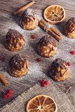 Cakes on a wooden table. Cake with boiled condensed milk and chocolate. Selective focus.  royalty free stock photos