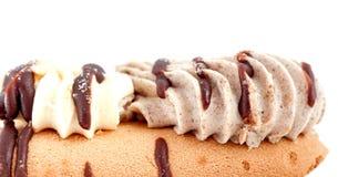 Cakestukken van chocolade en vanille het vullen Stock Foto