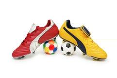 Calçados do futebol imagens de stock