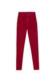 Calças altas magros vermelhas das calças de brim da cintura, isoladas no fundo branco Imagem de Stock