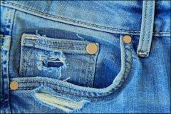 Calças de brim azuis da sarja de Nimes com bolso e botões Imagens de Stock Royalty Free