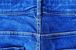 Calças de brim azuis da sarja de Nimes com bolso e botões Imagem de Stock