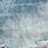 Calças de brim azuis gastas textura da sarja de Nimes, fundo Foto de Stock