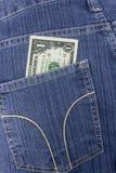 Calças de brim bolso e dólar Imagens de Stock Royalty Free
