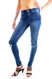 Calças de brim, calças de brim vestindo da cintura da mulher Imagens de Stock Royalty Free