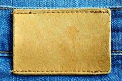 Calças de brim com etiqueta de couro em branco Imagens de Stock