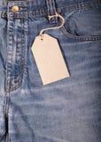 Calças de brim com etiquetas do cartão Imagens de Stock