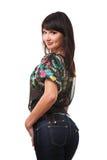 Calças de brim desgastando da mulher triguenha atrativa Imagem de Stock Royalty Free