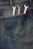 Calças de brim e ferramentas Fotos de Stock