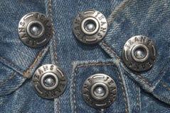 Calças de brim e teclas Imagem de Stock