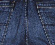 Calças de brim materiais Foto de Stock