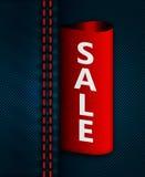 Calças de brim sam com etiqueta vermelha da venda Imagens de Stock