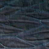 Calças de brim textura da sarja de Nimes ou fundo das calças de brim da sarja de Nimes com velho rasgado Projeto velho da forma d Imagem de Stock