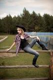 Calças de brim vestindo da rapariga Imagem de Stock Royalty Free
