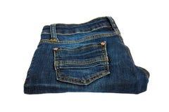 A calças de ganga das mulheres em um fundo branco Imagem de Stock Royalty Free