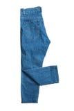 A calças de ganga fecha-se acima no branco Imagens de Stock