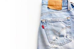 Calças de ganga no fundo branco Fotografia de Stock