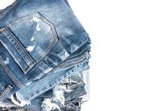 A calças de ganga rola acima as calças isoladas Imagem de Stock Royalty Free