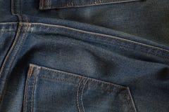 Calças de ganga traseira do detalhe fotografia de stock