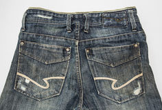 Calças de ganga traseira do detalhe Foto de Stock Royalty Free