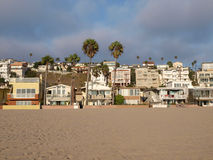 So Cal Beach Culture. Southern California Beach life.  Sand, sun, homes under palm trees Stock Images