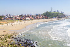 Cal beach in Torres in a sunny day. Sunny day with waves and blue sky at Cal beach, Torres, Rio Grande do Sul Stock Photos