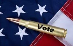 50 Cal Bullet med röstar på det Royaltyfria Bilder