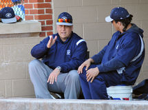 Cal Ripken Jr. Coaching High School Baseball. TOWSON, MD - MARCH 29: Baseball Hall of Famer Cal Ripken Jr. (l) shown on the bench as he coaches for Gilman HS in Stock Photography