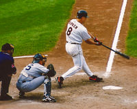 Cal Ripken makes contact on a pitch. Royalty Free Stock Photography