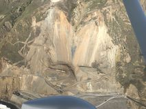 Active mud creek landslide aerial photo january 2018. Cal Trans works to build a new road after a portion of Hwy 1 was buried under a massive rock slide. The Stock Photos
