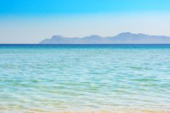 Beautiful clear beach Cala Alcudia, Mallorca, Spain. Cala Alcudia, Mallorca, Spain. Beautiful and calm Alcudia beach is shallow with warm water and ideal for Stock Photo