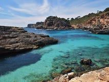 Cala Almonia beach. Bay azure sea water, at Majorca in Spain Stock Photo