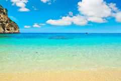 Cala Biriola beach under soft clouds Stock Photo