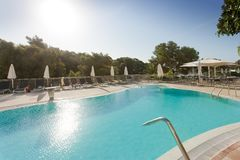 Cala d`Or, Mallorca - AUGUST 2016 - Sundown at the pool while no. Cala d`Or, Mallorca, Spain - AUGUST 2016 - Sundown at the pool while nobody else is around Stock Photos