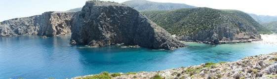 Cala Domestica Sardinia. Set in a wild corner of the south-western coast, among white calcareous cliffs, the inlet of Cala Domestica delights the eyes of the Royalty Free Stock Image