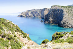 Cala Domestica Sardinia. Set in a wild corner of the south-western coast, among white calcareous cliffs, the inlet of Cala Domestica delights the eyes of the Stock Photos