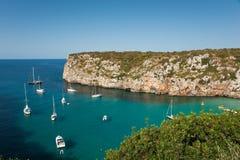 Cala En Porter. Landscape of Cala En Porter, Menorca, detailing the cliffs and several boats Royalty Free Stock Photos