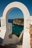 Cala en Porter arch. View of Cala en Porter bay through white arch against clear blue sky Royalty Free Stock Photography