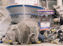 Cala Figuera fishnets and fishing boat in port Royalty Free Stock Image