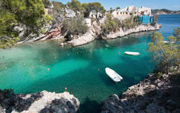 Cala Fornells beach. CALA FORNELLS, MALLORCA, SPAIN - SEPTEMBER 6, 2016: Green water beach, bathers and boats on a sunny day on September 6, 2016 in Cala stock photo