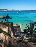 Cala Fornells beach. CALA FORNELLS, MALLORCA, SPAIN - SEPTEMBER 6, 2016: Green water beach, bathers and boats on a sunny day on September 6, 2016 in Cala royalty free stock image