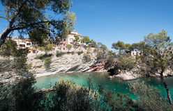 Cala Fornells beach. CALA FORNELLS, MALLORCA, SPAIN - SEPTEMBER 6, 2016: Green water beach, bathers and boats on a sunny day on September 6, 2016 in Cala stock photography